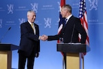 Defense Secretary James N. Mattis shakes hands with his Norwegian counterpart.