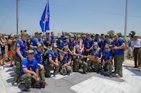 The Rucking Raiders pose for a picture at the Memorial Marker, after the dedication ceremony, before beginning the 900 mile ruck march from Greenwood, Miss. To Camp Lejeune, N.C., on July 14, 2018. The Rucking Raiders, consisting of 4 rotating teams, are carrying dirt from the crash site of the fallen Marines and Sailor, back to the home station of Camp Lejeune, N.C.