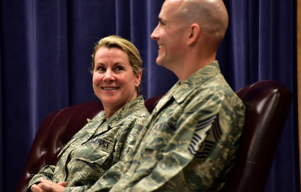 Outgoing 166th Airlift Wing Command Chief Master Sgt. Shaune Peters, left, looks on as her successor, Command Chief Master Sgt. William Horay, is introduced during their change of authority ceremony held at the New Castle ANG Base, Del. on July 14, 2018. (U.S. Air National Guard photo by Staff Sgt. Nathan Bright)