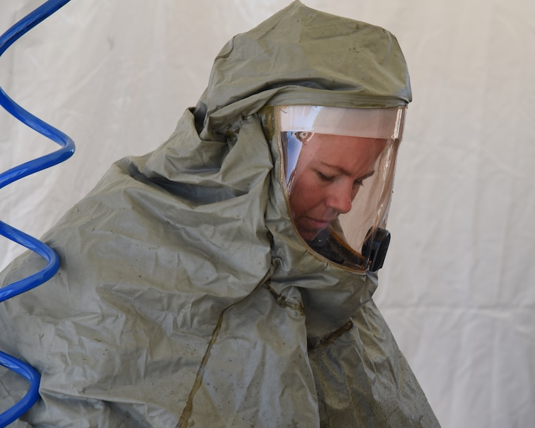 Tech. Sgt. Charity Stuart, an In-Place Patient Decontamination team member, processes a patient through an IPPD station during an exercise at the Goldwater Air National Base, May 22. The purpose of the exercise was to train and evaluate the IPPD team's ability to receive and decontaminate patients in preperation to be elivated to a higher level of medical care. (U.S. Air National Guard photo by Staff Sgt. Wes Parrell)