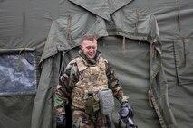 Staff Sgt. Phillip Laugle, 374th Logistics Readiness Squadron fuel service center supervisor, exits
