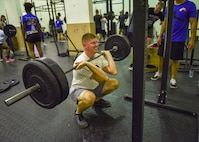U.S. Air Force Staff Sgt. Brian Greilich, 39th Communications Squadron cable and antenna systems technician, squats during a Crossfit session at Incirlik Air Base, Turkey, July 9, 2018.