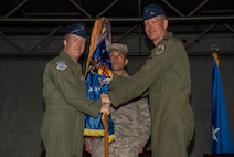 U.S. Air Force Brig. Gen. Todd A. Doizer, Fifth Air Force vice commander, left, and Col. Kristopher W. Struve, 35th Fighter Wing commander, right, pause for a photo during the passing of the guidon at Misawa Air Base, Japan, July 16, 2018. The guidon symbolizes the relinquishment of command from the outgoing commander to the incoming commander. (U.S. Air Force photo by Airman 1st Class Collette Brooks)