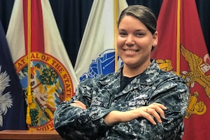 Navy recruiter poses in her office.