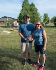 Zack Storms, left, and Natalie Main, took first place in  and Robert Laviolette 434th Civil Engineer Squadron pose with their trophy for winning the spouse bracket of the first Grissom corn hole tournament here July 14, 2018. The 434th AMDS swept the competition defeating the 434th Force Support Squadron in the final round. (U.S. Air Force photo/Staff Sgt. Jami K. Lancette)