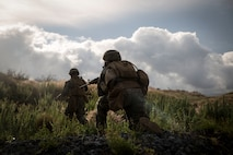 POHAKULOA TRAINING AREA, Hawaii - U.S. Marines with Bravo Company, 1st Battalion, 3rd Marine Regiment, maneuver to secure a notional enemy position during a live-fire training event as part of Rim of the Pacific exercise at Pohakuloa Training Area, Hawaii, July 13, 2018.