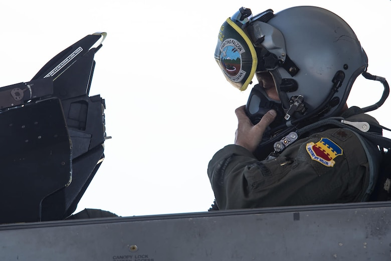 U.S. Air Force Maj. David Paulus, 77th Fighter Squadron (FS) assistant to the director of operations, adjusts his oxygen mask at Shaw Air Force Base, S.C., July, 9, 2018.