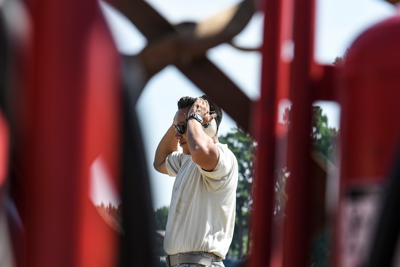 U.S. Air Force Senior Airman Daniel Abbiati, 20th Aircraft Maintenance Squadron support technician, adjusts his hearing protection on the flight line at Shaw Air Force Base, S.C., July 11, 2018