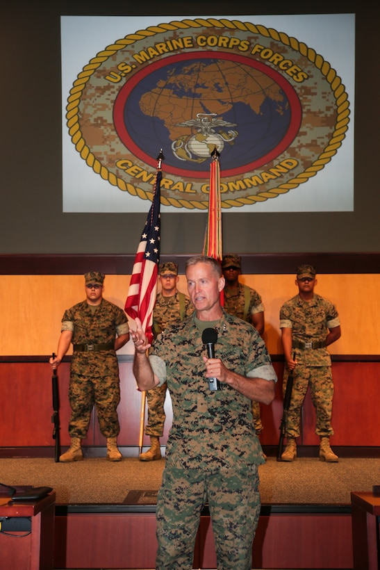 Lieutenant General Carl E. Mundy, III, the new commander of United States Marine Corps Forces, Central Command addresses the service members and attendees during the MARCENT change of command ceremony, at the Vince Tolbert Building at MacDill Air Force Base, July 11. Mundy assumed command from Lt. Gen. William D. Beydler, who has served as the MARCENT Commander since Oct. 27, 2015. (Photo by Tom Gagnier)