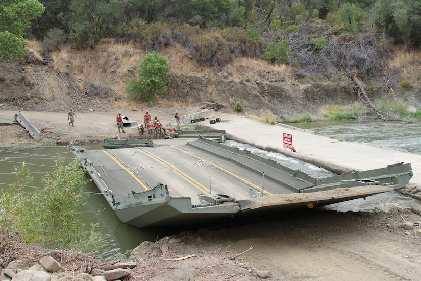 Engineers assemble a floating bridge.