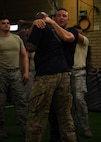 Allen Payne, Krav Maga Instructor, demonstrates a defensive maneuver during training at the Tactical Integrated Training and Nutrition Arena July 12, 2018, at Luke Air Force Base, Ariz.