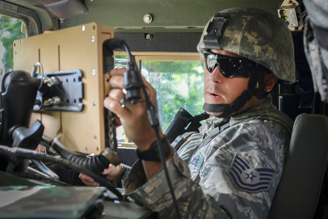 An airman inputs grid coordinates into a Blue Force Tracker System.
