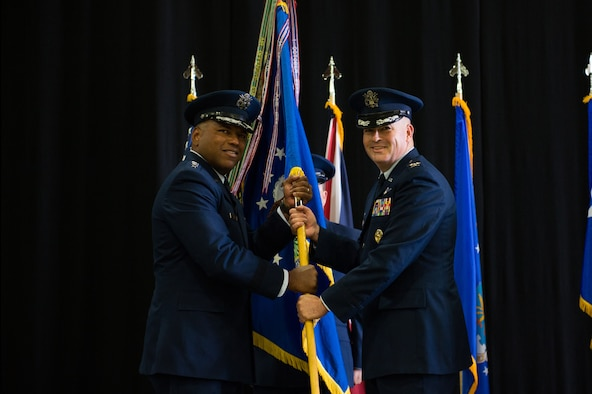 Col. William Marshall assumes command of the 48th Fighter Wing from Lt. Gen. Richard Clark, 3rd Air Force commander, during a change of command ceremony at Royal Air force Lakenheath, England, July 16, 2018. Marshall was accompanied by his wife, Lt. Col. Heather Marshall and their two sons. (U.S. Air Force photo by Airman 1st Class Shanice Williams-Jones)