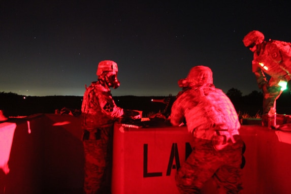 Task Force Ultimate range safety officers engage targets at night