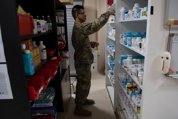 Tech. Sgt. Julian Ray Tayag, 386th Expeditionary Medical Group pharmacy technician from Joint Base San Antonio-Lackland, does inventory of the medication in the pharmacy at an undisclosed location in Southwest Asia May 7, 2018.