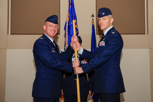 Col. Trevor Wentlandt, 460th Mission Support Group incoming commander, receives the guidon from Col. Troy Endicott, 460th Space Wing commander, at a change of command ceremony July 12, 2018, on Buckley Air Force Base, Colorado. The changing of the guidon symbolizes the official change of command. (U.S. Air Force photo by Airman 1st Class Jake Deatherage)
