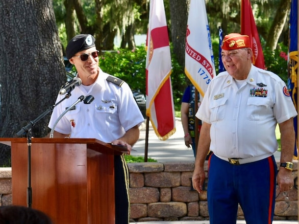 U.S. Army Brig. Gen. Paul Bontrager, U.S. Central Command deputy director of operations, left, and Hillsborough County Veterans Council member Walt Raysick, right, address attendees during a Field of Honor ceremony July 14, 2018 at the Veterans Memorial Park near Tampa, Fla. The ceremony honors the U.S. military and law enforcement personnel who have paid the ultimate sacrifice in the line of duty. (U.S. Air Force photo by Capt. Glenna Lambert)