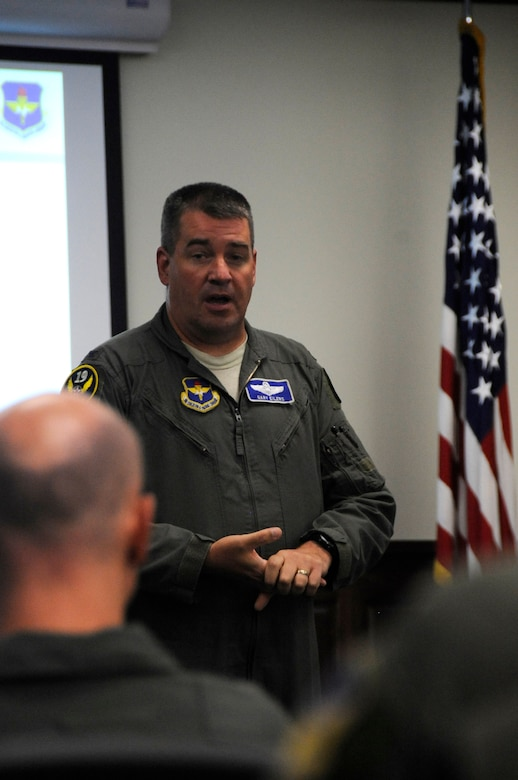 U.S. Air Force Col. Gary Eilers,19th Air Force director of operations briefs participants inside the Danielson Auditorium during the Air Education and Training Command Remotely Piloted Aircraft training enhancement summit atJoint Base San Antonio-Randolph, Texas, July 11, 2018. The three-day summit hosted by AETC provided an opportunity for leaders across the RPA enterprise to explore innovative ways to improve training. (U.S. Air Force photo by Tech. Sgt. Ave I. Young)