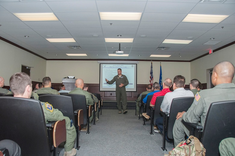 U.S. Air Force Col. Gary Eilers, 19th Air Force director of operations, briefs participants inside the Danielson Auditorium during the Air Education and Training Command Remotely Piloted Aircraft training enhancement summit at Joint Base San Antonio-Randolph, Texas, July 11, 2018. Leaders across the RPA enterprise gathered to circulate innovative ideas and solutions to alleviate stress in the production pipeline and create enhanced training capabilities for instructors.(U.S. Air Force photo by Tech. Sgt. Ave I. Young)