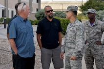 Louis Garland and Clayton Garland, decedents of late Chief Warrant Officer Louis F. Garland, meet with U.S. Air Force Ricky Mills, 17th Training Wing commander and Chief Master Sgt. Lavor Kirkpatrick, 17th TRW command chief, at the Norma Brown building on Goodfellow Air Force Base, Texas, July 13, 2018. Mills met with the Garlands before their tour of the Louis F. Garland Department of Defense Fire Academy. (U.S. Air Force photo by Senior Airman Randall Moose/Released)