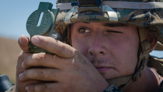 U.S. Marine Corps Pfc. Alex W. Michael, an antitank missile gunner with 1st Tank Battalion, 1st Marine Division (MARDIV), looks through a lensatic compass during the Rifle Squad Competition on Marine Corps Base Camp Pendleton, Calif., June 27, 2018