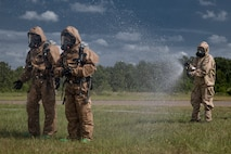 U.S. Marines with Chemical, Biological, Radiological, and Nuclear (CBRN) Platoon, Headquarters Battalion, 1st Marine Division, are sprayed down decontamination during the Concept of Real World CBRN Operations course at the Guardian Centers in Perry, Georgia, June 22, 2018.