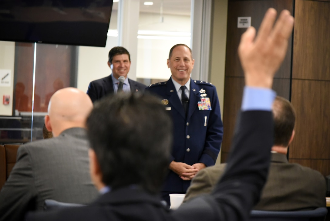 "Lt. Gen. Lee K. Levy II, front, speaks at an event June 28 after being introduced by Daniel Pullin, dean of the University of Oklahoma Price College of Business. June 28. He was the inaugural speaker of a distinguished speaker series hosted at the Gene Rainbolt Graduate School of Business. His lecture centered on the theme of ""Intersection of Innovation + Armed Services."""