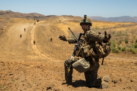 A U.S. Marine with 1st Light Armored Reconnaissance Battalion, 1st Marine Division (MARDIV), gives hand and arm signals during the Rifle Squad Competition on Marine Corps Base Camp Pendleton, Calif., June 27, 2018.