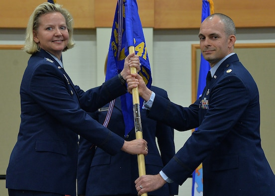 Maj. Darren Mattheis, right, accepts command of the 341st Comptroller Squadron from Col. Jennifer Reeves, 341st Missile Wing commander during a change of command ceremony July 16, 2018, at the Grizzly Bend on Malmstrom AFB, Mont.