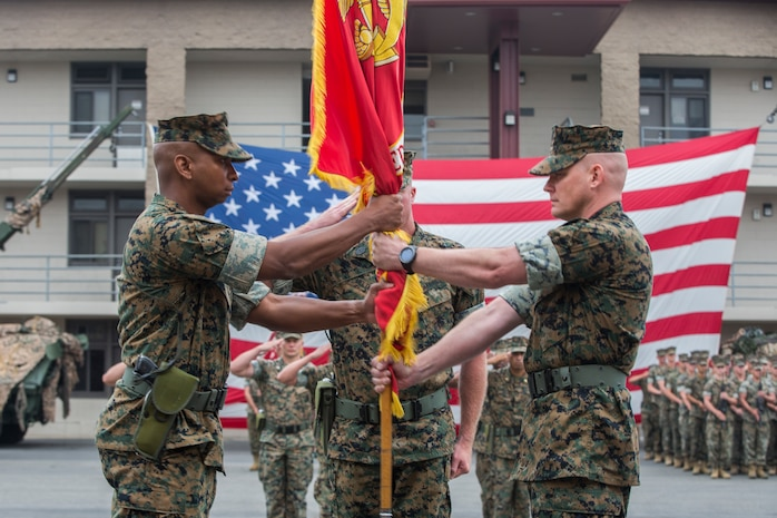 U.S. Marine Corps Lt. Col. Dominique B. Neal, left, the incoming commanding officer, recieves the battalion colors from Lt. Col. Michael R. Nakonieczy, right, the offgoing commanding officer, during the 1st Light Armored Reconnaissance Battalion, 1st Marine Division, change of command ceremony at Marine Corps Base Camp Pendleton, Calif., June 21, 2018.