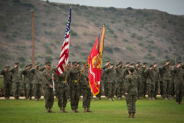 U.S. Marine Corps color guard with 1st Combat Engineer Battalion (CEB), 1st Marine Division, present the colors during a change of command ceremony at Marine Corps Base Camp Pendleton, Calif., June 22, 2018.