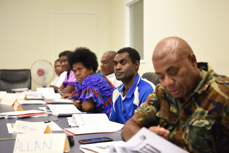 Vanuatu Mobile Force personnel, Vanuatu Ministry of Health professionals and nongovernmental organization personnel from Luganville, Espiritu Santo Island and Tanna, Tanna Island, Vanuatu, attend a subject matter exchange on vector-borne disease control as part of Pacific Angel (PAC ANGEL) 18-3 in Luganville, Vanuatu, July, 10, 2018.