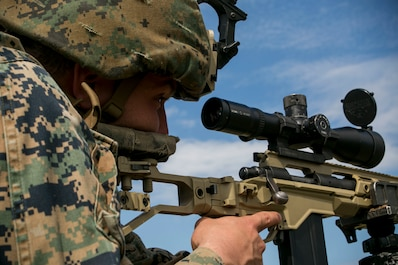 A U.S. Marine with Black Sea Rotational Force 18.1 sights in on a target with an M40A6 sniper rifle during a deployment for training exercise at Novo Selo Training Area, Bulgaria