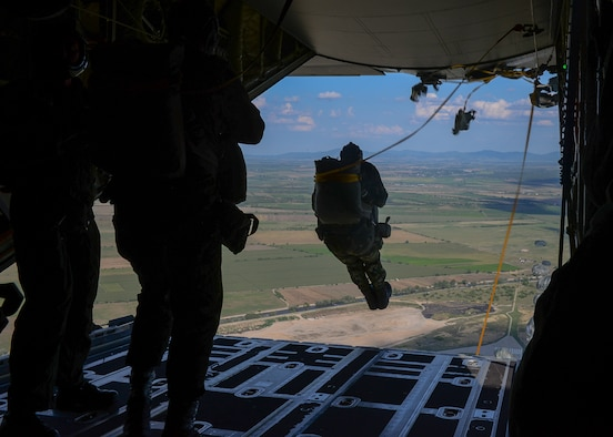 A Bulgarian jumper performs a static-line jump from a U.S. Air Force C-130J Super Hercules aircraft over Plovdiv, Bulgaria, July 14, 2018. During Thracian Summer 2018, U.S. and Bulgarian forces trained both static-line jumps and free falls. (U.S. Air Force photo by Staff Sgt. Jimmie D. Pike)