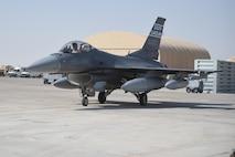 A jet sits on a flightline