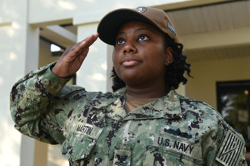U.S. Navy Ships Serviceman 1st Class La'Tasha Martin, Naval Support Activity Charleston unaccompanied personnel housing office, salutes the American Flag at Joint Base Charleston's Naval Weapons Station June 20, 2018. Martin was the one Sailor selected through the Meritorious Advancement Program at NSA Charleston to be advanced to the paygrade of E6 this year. The MAP is intended to give commanders the opportunity to recognize their best Sailors and shape their workforce by developing and rewarding their most talented enlisted members.
