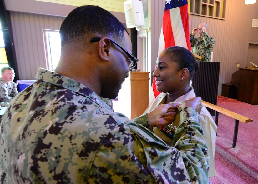 U.S. Navy Ships Serviceman 1st Class La'Tasha Martin, right, Naval Support Activity Charleston unaccompanied personnel housing office, is meritoriously advanced to the paygrade of E-6 during a promotion ceremony at Joint Base Charleston's Naval Weapons Station June 20, 2018. Martin was the one Sailor selected through the Meritorious Advancement Program at NSA Charleston to be advanced to the paygrade of E6 this year. The MAP is intended to give commanders the opportunity to recognize their best Sailors and shape their workforce by developing and rewarding their most talented enlisted members.
