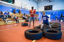 Children from the 100th Force Support Squadron Youth Center compete for the best time during an Alpha Warrior obstacle course challenge at the Northside Fitness Center on RAF Mildenhall, England, July 13, 2018. Not only does the battle rig test physically fitness, but it can be used on a daily basis for workouts or unit physical training. (U.S. Air Force photo by Senior Airman Christine Groening)