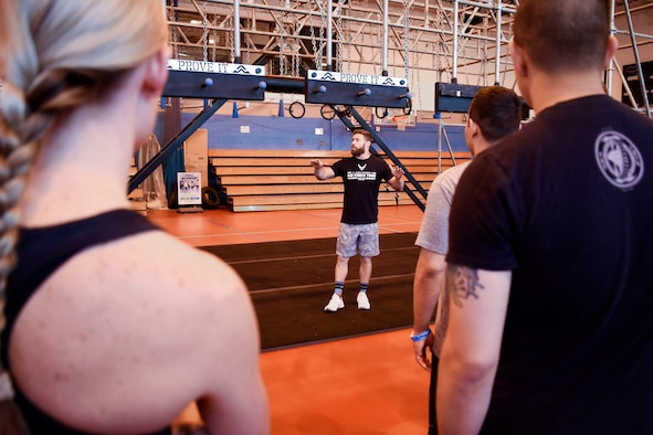Eric Rosenstock, Alpha Warrior pro athlete and coach, briefs Team Mildenhall Alpha Warrior competitors on how to use the Alpha Warrior battle rig at the Northside Fitness Center on RAF Mildenhall, England, July 13, 2018. The battle rig can be used to test individual physical fitness and for unit physical training. (U.S. Air Force photo by Senior Airman Christine Groening)