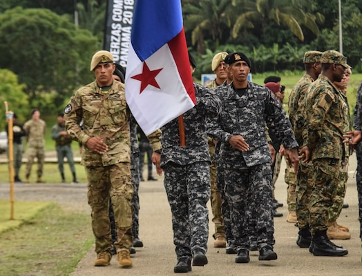 Panamanian Comandos return to their place after passing the torch during the opening ceremony for Fuerzas Comando