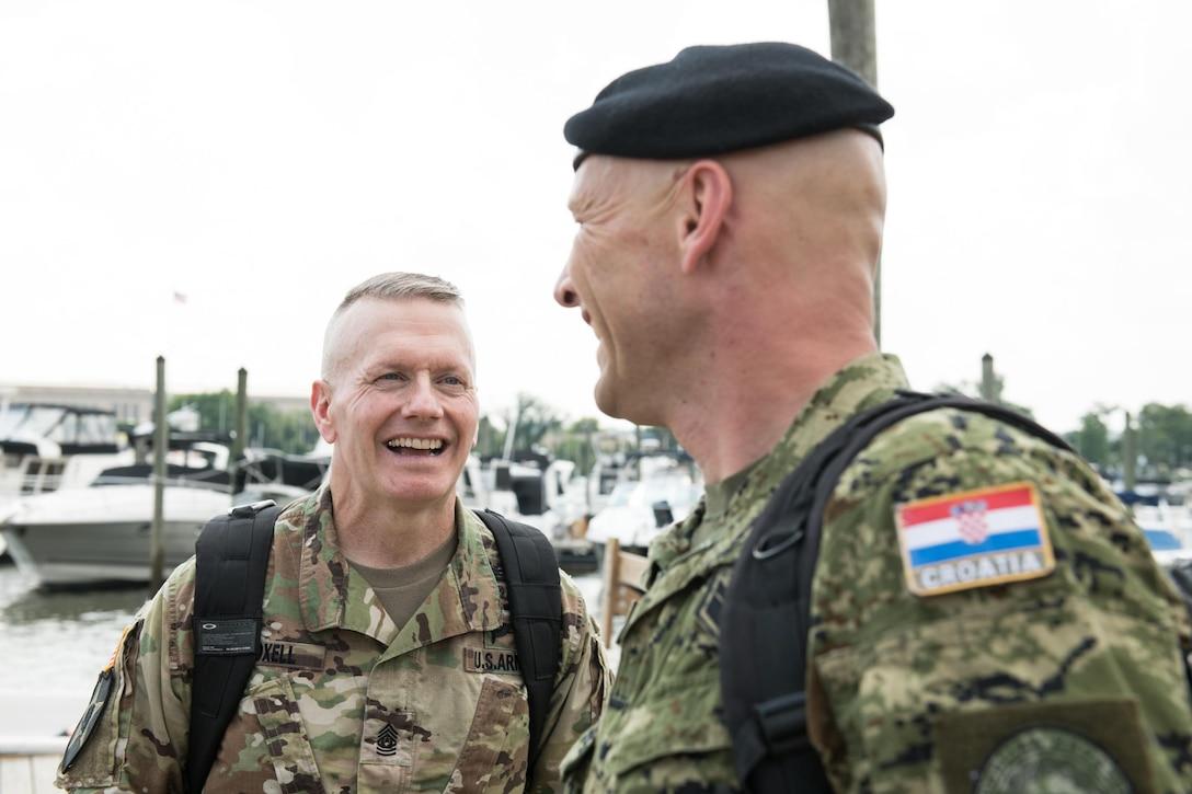 Army Command Sgt. Maj. John W. Troxell talks to a Croatian service member.