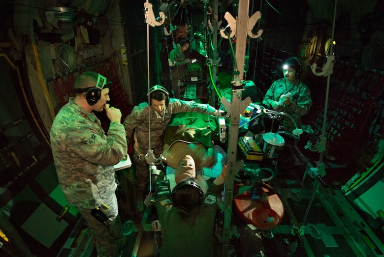 Flight Nurse and Aeromedical Technician Course students care for a simulated patient during a simulated Aeromedical Evacuation mission aboard a C-130 mockup at the 711th Human Performance Wing's U.S. Air Force School of Aerospace Medicine at Wright Patterson AFB, Ohio, Jan. 29, 2018. (U.S. Air Force photo by J.M. Eddins Jr.)