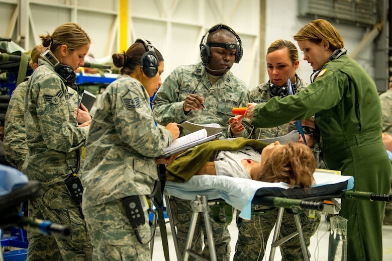 Flight Nurse and Aeromedical Technician Course students discuss patient briefs from actual Aeromedical Evacuation missions with their instructor, Capt. Sarah Johnson, right, before boarding a C-130 mockup to treat simulated patients at the 711th Human Performance Wing's U.S. Air Force School of Aerospace Medicine at Wright Patterson AFB, Ohio, Jan. 29, 2018. (U.S. Air Force photo by J.M. Eddins Jr.)