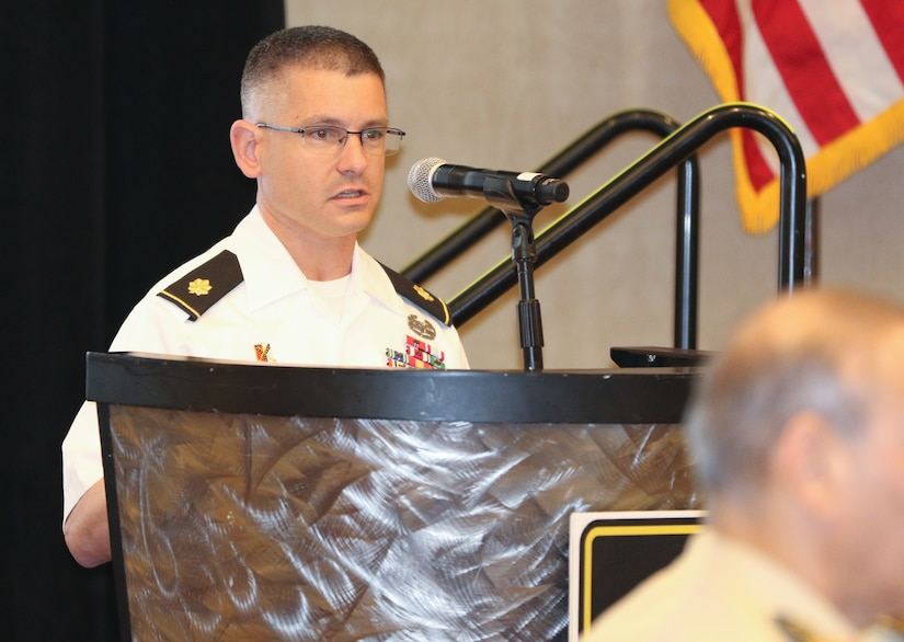 Maj. Ryan O'Reilly, strategic planner, U.S. Army Central, introduces the concept of a Coalition Land Operations Center as a driver for coalition interoperability that would operationalize a regional land power network between USARCENT and partner nations at the 2018 Senior Strategy Session – Arabian Peninsula / Levant in Arlington, Va, July 10, 2018. Ideally, CLOC would better enable mission command, information and intelligence sharing, collaboration and standardization for potential coalition constructs in advance of crises and future operations. Over the four-day conference, speakers and participants will engage in discussions centering on the complexities and lessons learned from Joint, Interagency, Intergovernmental and Multinational (JIIM) efforts during ongoing theater campaigns that have global implications.