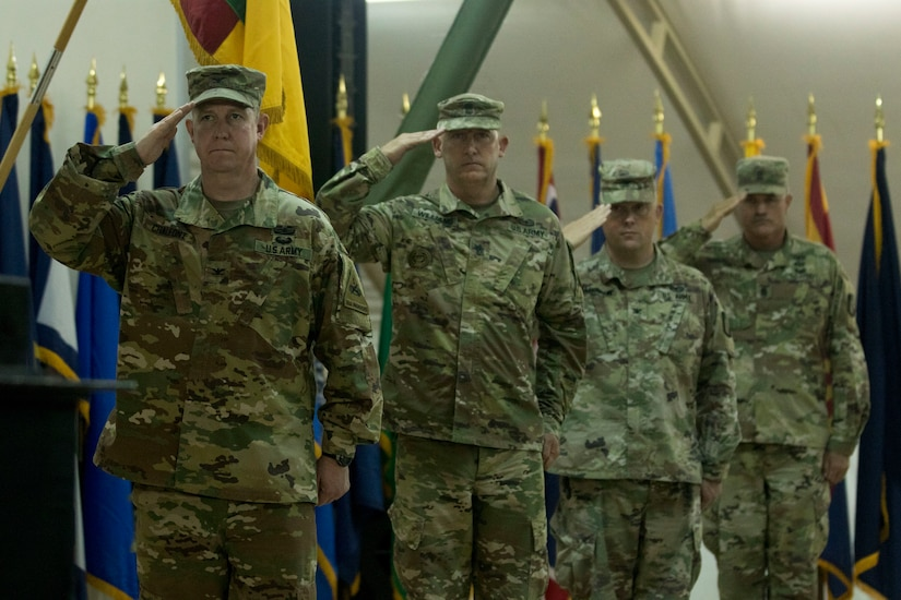 Senior leaders of the 2nd Brigade, 1st Armored Division, and the 155th Armored Brigade Combat Team, Mississippi Army National Guard, salute the United States flag during a ceremony held to transfer authority between the two units at Camp Buehring, Kuwait, July 15, 2018. The ceremony was the final step in the process of the 155th ABCT assuming operational responsibility from the 2nd BDE, 1st AD.