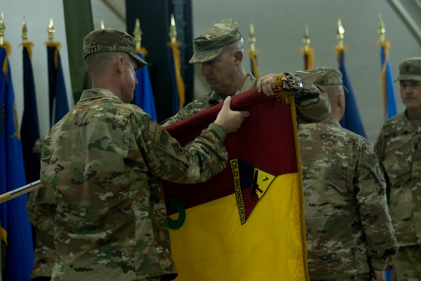 U.S. Army Col. Chad Chalfont, commander of the 2nd Brigade, 1st Armored Division, and Command Sgt. Maj. Michael Williams, the command sergeant major of 2nd BDE, 1st AD, cases the unit colors while transferring authority to the 155th Armored Brigade Combat Team, at Camp Buehring, Kuwait, July 15, 2018. Chalfont said he was proud of the work his Soldiers had accomplished to improve readiness in the area of operations during their deployment.