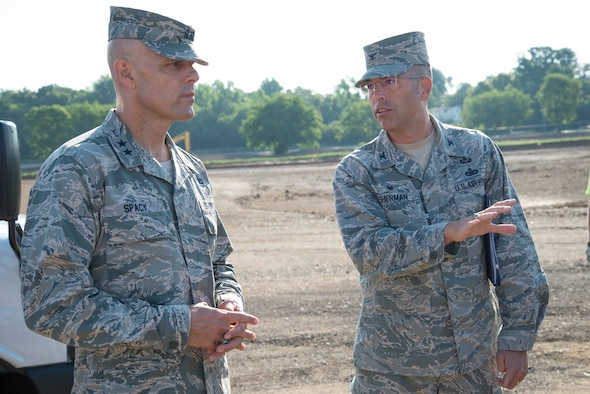 Col. Thomas Sherman, 88th Air Base Wing and Installation commander, talks to Maj. Gen. Bradley D. Spacy, Air Force Installation and Mission Support Center commander, about construction at the new Gate 26A site during the general's visit to the installation July 12, 2018.
