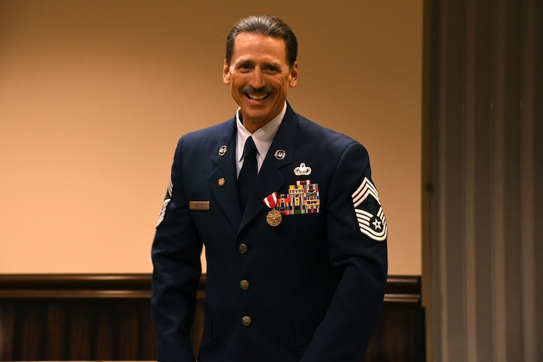 Chief Master Sgt. Robert L. Walter, 94th Force Support Squadron superintendent, smiles during his retirement ceremony held here July 14, 2018. Walter retired after 36 years of service in the active-duty Air Force, Air National Guard and, most recently, the Air Force Reserve. (U.S. Air Force photo/Senior Airman Josh Kincaid)