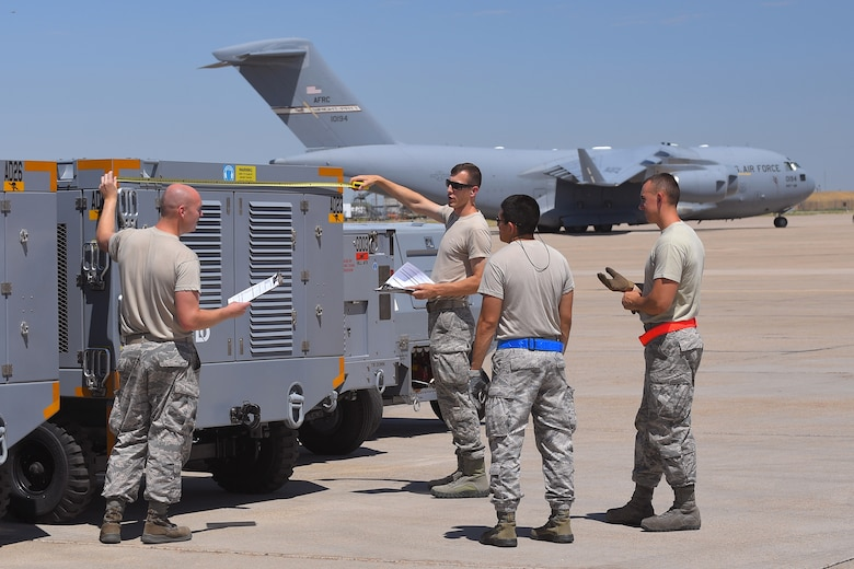 (Left to right) Staff Sgt. Joshua Echols and Tech. Sgt. Zachary Burson, 75th Logistics Readiness Squadron, along with Staff Sgts. Adan Nunez and Justin Murphy, 388th Maintenance Squadron, measure equipment during an exercise July 13, 2018, at Hill Air Force Base Utah. (U.S. Air Force photo by Todd Cromar)