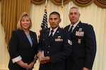 From left to right: Cynthia S. Tolle, the director of acquisitions and head of contracting activities for the National Guard Bureau, Air Force Staff Sgt. Luis Juro, an engineering assistant and contracting officer representative with the Connecticut Air National Guard's 103rd Airlift Wing, and Air Force Lt. Col. Henry Chmielinski, a squadron commander with the 103rd Airlift Wing, pose for a photograph during the Excellence in Contracting Awards Program at Fort Belvoir, Virginia, July 12, 2018. Juro won in the Excellence in Contract Administration category and was one of ten winners at the ceremony that recognized the achievements and contributions of contracting specialists throughout the National Guard.